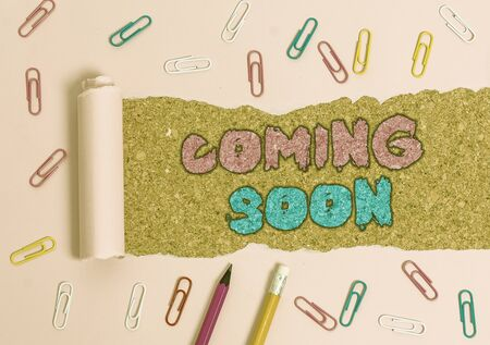Writing note showing Coming Soon. Business concept for something is going to happen in really short time of period