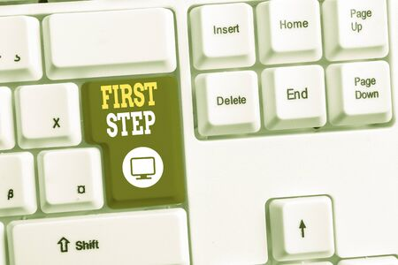 Text sign showing First Step. Business photo text Pertaining to the start of a certain process or beginning White pc keyboard with empty note paper above white background key copy space