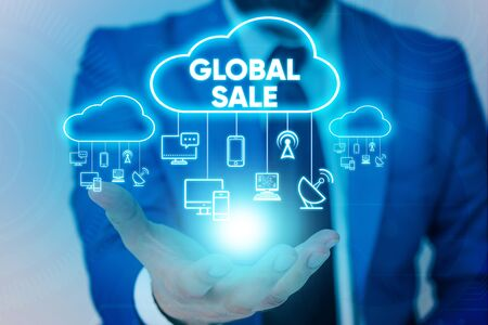 Handwriting text Global Sale. Conceptual photo analysisagers operations for companies do business internationally Male human wear formal work suit presenting presentation using smart device