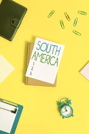 Handwriting text South America. Conceptual photo Continent in Western Hemisphere Latinos known for Carnivals Paper clips with blank papers for text messages