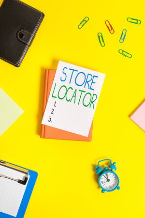 Handwriting text Store Locator. Conceptual photo to know the address contact number and operating hours Paper clips with blank papers for text messages