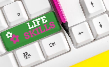 Conceptual hand writing showing Life Skills. Concept meaning that is necessary or desirable full participation in everyday White pc keyboard with note paper above the white background