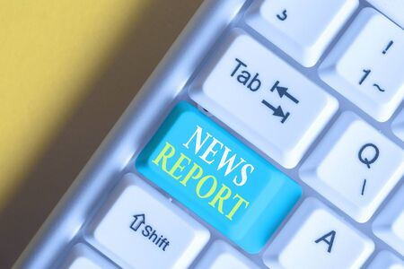 Word writing text News Report. Business photo showcasing spoken or written account of something that one has observed White pc keyboard with empty note paper above white background key copy space Stok Fotoğraf