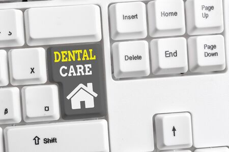 Text sign showing Dental Care. Business photo showcasing maintenance of healthy teeth or to keep it clean for future White pc keyboard with empty note paper above white background key copy space Banque d'images