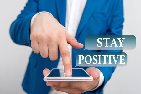 Text sign showing Stay Positive. Business photo showcasing Engage in Uplifting Thoughts Be Optimistic and Real Businessman in the blue suite with lap top pointing with finger