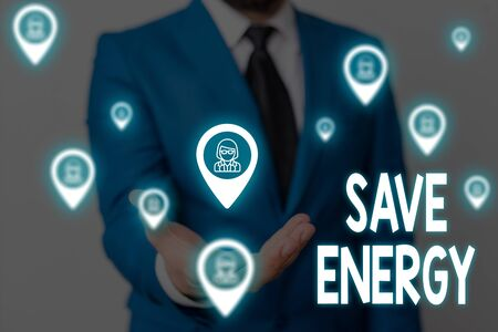 Handwriting text Save Energy. Conceptual photo decreasing the amount of power used achieving a similar outcome Male human wear formal work suit presenting presentation using smart device