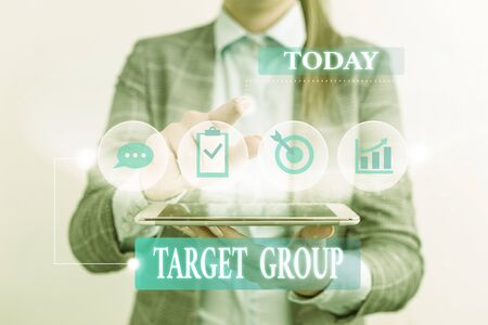 Word writing text Target Group. Business photo showcasing Particular showing that an advertisement intended to reach to Female human wear formal work suit presenting presentation use smart device Banco de Imagens