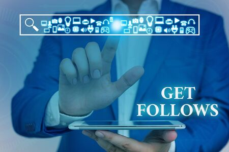 Word writing text Get Follows. Business photo showcasing demonstrating who imitates copies or takes as model ideal demonstrating Male human wear formal work suit presenting presentation using smart device
