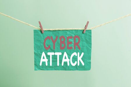Writing note showing Cyber Attack. Business concept for An attempt by hackers to Damage Destroy a Computer System Clothesline clothespin rectangle shaped paper reminder white wood desk 版權商用圖片