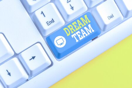 Text sign showing Dream Team. Business photo showcasing Prefered unit or group that make the best out of a demonstrating White pc keyboard with empty note paper above white background key copy space Stock fotó