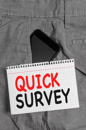 Handwriting text Quick Survey. Conceptual photo Conduct fast check on condition value situation of something Smartphone device inside formal work trousers front pocket near note paper