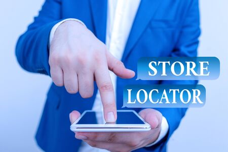 Text sign showing Store Locator. Business photo showcasing to know the address contact number and operating hours Businessman in the blue suite with lap top pointing with finger