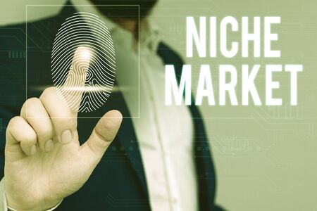 Writing note showing Niche Market. Business concept for Subset of the market on which specific product is focused Male wear formal work suit presenting presentation smart device 스톡 콘텐츠