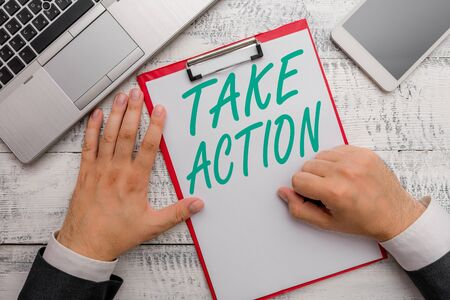 Conceptual hand writing showing Take Action. Concept meaning advices someone to do something or reaction right now