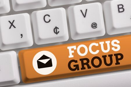 Word writing text Focus Group. Business photo showcasing showing assembled to participate in discussion about something White pc keyboard with empty note paper above white background key copy space Stock Photo