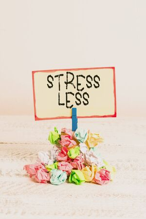 Writing note showing Stress Less. Business concept for Stay away from problems Go out Unwind Meditate Indulge Oneself Reminder pile colored crumpled paper clothespin wooden space 版權商用圖片