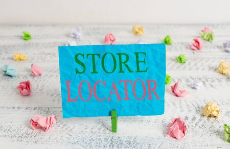 Word writing text Store Locator. Business photo showcasing to know the address contact number and operating hours Green clothespin white wood background colored paper reminder office supply