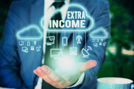 Writing note showing Extra Income. Business concept for Additional fund received or earned from a non regular basis Male wear formal work suit presenting presentation smart device