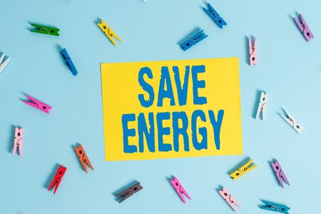 Handwriting text Save Energy. Conceptual photo decreasing the amount of power used achieving a similar outcome Colored clothespin rectangle shaped reminder paper light blue background