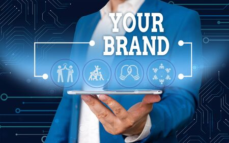 Conceptual hand writing showing Your Brand. Concept meaning A name of any kind that is impacted to something as trademark Male wear formal work suit presenting presentation smart device