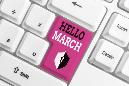 Text sign showing Hello March. Business photo text musical composition usually in duple or quadruple with beat White pc keyboard with empty note paper above white background key copy space Banco de Imagens