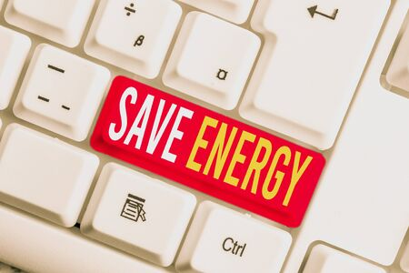 Handwriting text writing Save Energy. Conceptual photo decreasing the amount of power used achieving a similar outcome White pc keyboard with empty note paper above white background key copy space Stok Fotoğraf