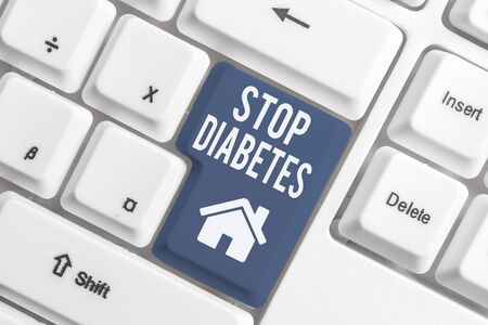 Conceptual hand writing showing Stop Diabetes. Concept meaning Blood Sugar Level is higher than normal Inject Insulin White pc keyboard with note paper above the white background