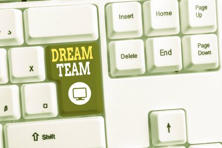 Text sign showing Dream Team. Business photo text Prefered unit or group that make the best out of a demonstrating White pc keyboard with empty note paper above white background key copy space
