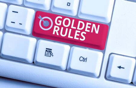 Handwriting text writing Golden Rules. Conceptual photo Basic principle that should be followed Important Principle White pc keyboard with empty note paper above white background key copy space
