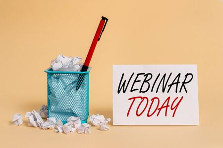 Text sign showing Webinar Today. Business photo showcasing live online educational presentation on different location crumpled paper trash and stationary with note paper placed in the trash can
