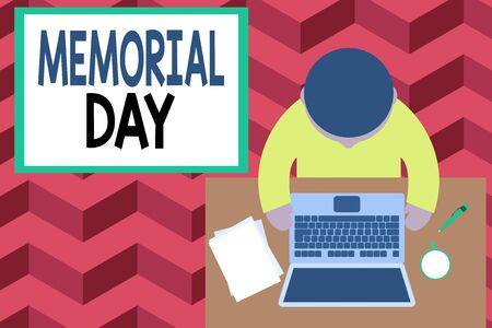 Word writing text Memorial Day. Business photo showcasing To honor and remembering those who died in military service Upper view young man sitting working table laptop documents coffee cup pen