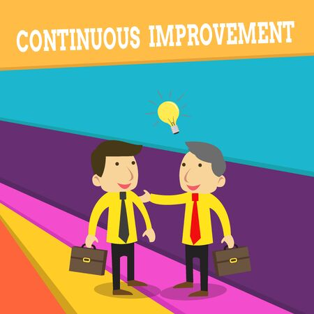 Word writing text Continuous Improvement. Business photo showcasing ongoing effort to improve products or processes Two White Businessmen Colleagues with Brief Cases Sharing Idea Solution Stock Photo