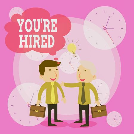 Conceptual hand writing showing You Re Hired. Concept meaning New Job Employed Newbie Enlisted Accepted Recruited Businessmen Colleagues with Brief Case Sharing Idea Solution