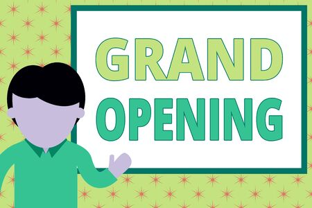 Handwriting text writing Grand Opening. Conceptual photo Ribbon Cutting New Business First Official Day Launching Young man standing in front whiteboard pointing to project. photo Art Imagens