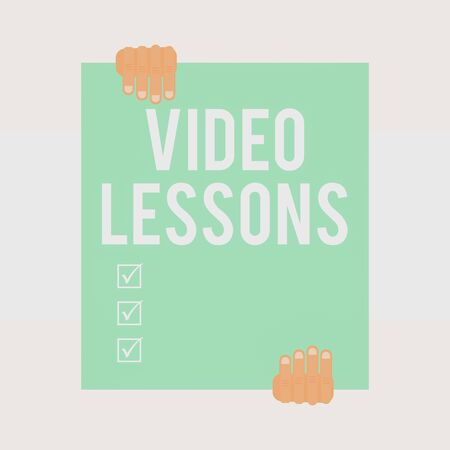 Writing note showing Video Lessons. Business concept for Online Education material for a topic Viewing and learning Two hands holding big blank rectangle up down Geometrical background