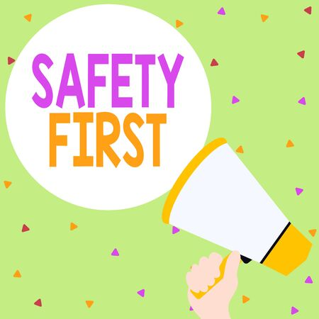 Handwriting text writing Safety First. Conceptual photo Avoid any unnecessary risk Live Safely Be Careful Pay attention Hand Holding Loudhailer Empty Round Speech Text Balloon Announcement New