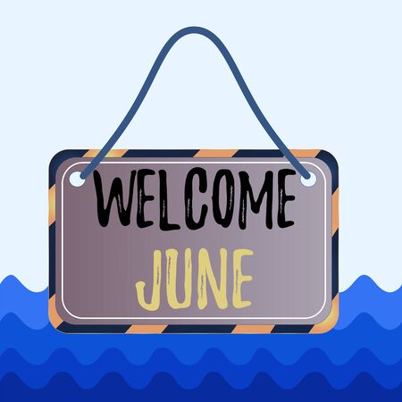 Conceptual hand writing showing Welcome June. Concept meaning Calendar Sixth Month Second Quarter Thirty days Greetings Board attach string color black yellow frame rectangle shape Фото со стока