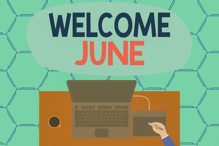 Conceptual hand writing showing Welcome June. Concept meaning Calendar Sixth Month Second Quarter Thirty days Greetings Laptop wooden desk worker drawing tablet coffee cup office