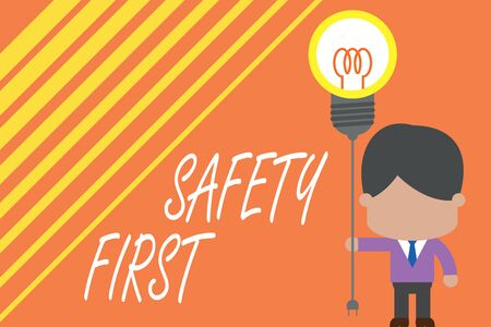 Word writing text Safety First. Business photo showcasing used to say that the most important thing is to be safe Standing man tie holding plug socket light bulb to connect idea. Startup 스톡 콘텐츠