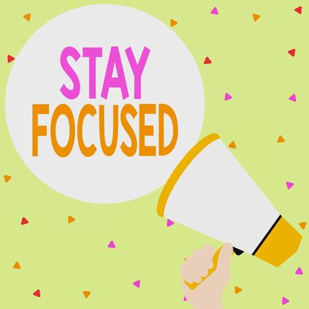 Handwriting text writing Stay Focused. Conceptual photo Be attentive Concentrate Prioritize the task Avoid distractions Hand Holding Loudhailer Empty Round Speech Text Balloon Announcement New