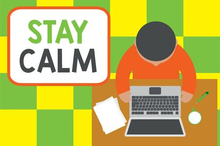 Conceptual hand writing showing Stay Calm. Concept meaning Maintain in a state of motion smoothly even under pressure Upper view young man sitting table laptop coffee cup pen