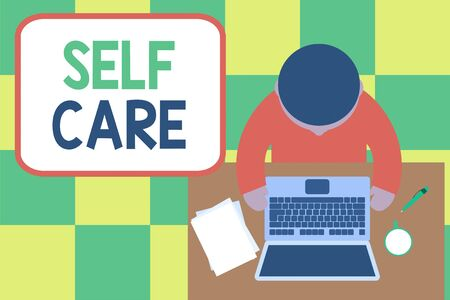 Conceptual hand writing showing Self Care. Concept meaning Give comfort to your own body without professional consultant Upper view young man sitting table laptop coffee cup pen Stock Photo