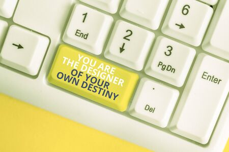 Writing note showing You Are The Designer Of Your Own Destiny. Business concept for Embrace life Make changes White pc keyboard with note paper above the white background