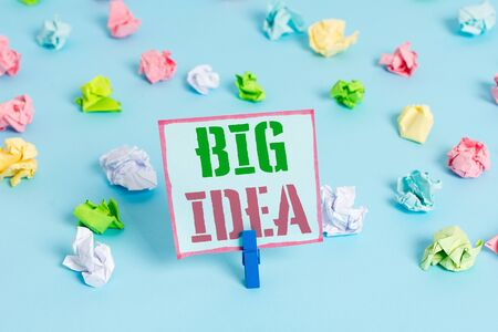 Word writing text Big Idea. Business photo showcasing Having great creative innovation solution or way of thinking Colored crumpled papers empty reminder blue floor background clothespin