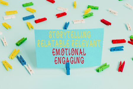 Handwriting text Story Telling relatablerele. Conceptual photo Storytelling Relatable Relevant Emotional Engaging Colored clothespin papers empty reminder blue floor background office pin