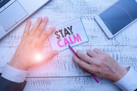 Writing note showing Stay Calm. Business concept for Maintain in a state of motion smoothly even under pressure Stock Photo