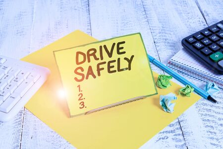 Conceptual hand writing showing Drive Safely. Concept meaning you should follow the rules of the road and abide laws Stock Photo