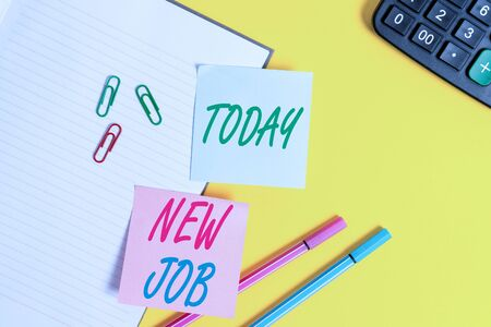 Text sign showing New Job. Business photo showcasing signing contract Finding work opportunity Seeking better salary Empty blue paper with copy space paper clips and pencils on the yellow table