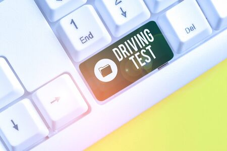 Writing note showing Driving Test. Business concept for procedure to test a demonstrating s is ability to drive a motor vehicle White pc keyboard with note paper above the white background Stock fotó