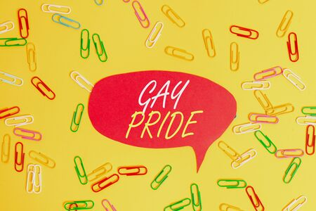 Handwriting text Gay Pride. Conceptual photo Dignity of an idividual that belongs to either a analysis or woanalysis Flat lay above empty paper with copy space and colored paper clips Imagens